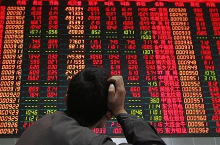A shareholder at a stock exchange market in southwest China's Sichuan province, March 26, 2007. Morgan Stanley former star economist Andy Xie warned of an imminent stock market crash in China -- but still hopes to raise money to invest in the country. REUTERS/Stringer