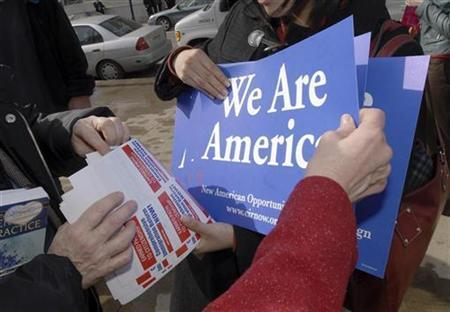 Supporters of immigrant issues handout flyers and literature at a rally in Scranton, Pennsylvania, March 12, 2007. Pro-immigration activists geared up for marches in several U.S. cities on Tuesday to demand rights for illegal immigrants, though numbers are likely to be down from the mass rallies of a year ago, organizers said. REUTERS/Bradley C Bower