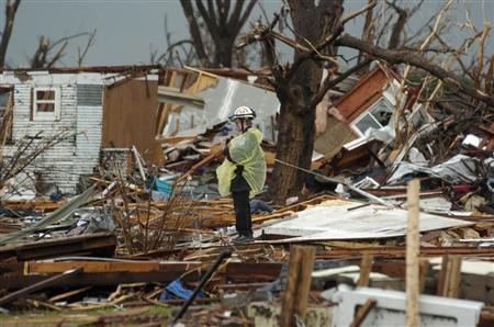 A rescue worker checks her camera after taking photos of the devastation in Greensburg, Kansas, May 6, 2007. REUTERS/Dave Kaup