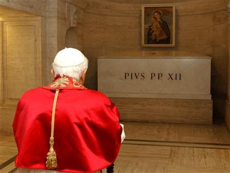 Pope Benedict XVI prays in front of the tomb of the late Pius XII (pope from 1939 to 1958) in the crypt of St. Peter's Basilica at the Vatican on the Day of the Dead November 2, 2005. Pope Pius XII, accused by critics of turning a blind eye to the death of Jews during World War Two, has moved a step closer to sainthood nearly five decades after his death, a Vatican source said on Wednesday. REUTERS/Osservatore Romano