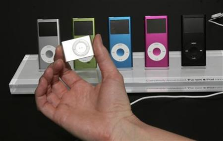 An Apple iPod Shuffle (foreground) and iPod Nanos are shown to the crowd at the Yerba Buena Center of the Arts theater in San Francisco, California in this file photo from September 12, 2006. REUTERS/Dino Vournas