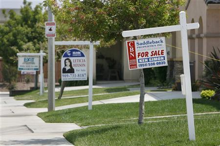 Three homes display ''For Sale' signs in a row on Palma Bonita Lane in Perris, California May 2, 2007. In the latter stages of the housing boom, armies of independent mortgage brokers like Musick, and a new breed of subprime lenders like Argent, helped bring a whole new class of borrowers to the housing market, a boom that led to bust for thousands. REUTERS/Mark Avery