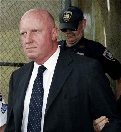 In this file photo former chief executive of Tyco International Dennis Kozlowski leaves New York State Supreme Court in New York City, June 17, 2005. Diversified manufacturer Tyco International said on Tuesday it agreed to take a $2.975 billion charge to settle most class-action lawsuits involving the stock and the former management, including former Chief Executive Dennis Kozlowski. REUTERS/Seth Wenig