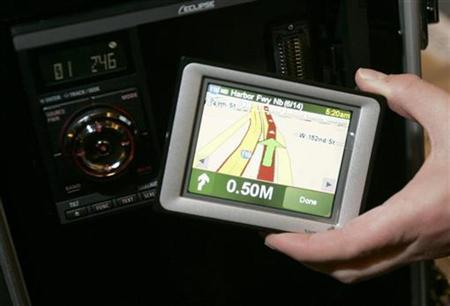 A model displays an auto in-dash navigation system in Las Vegas, Nevada, January 6, 2007. Three-dimensional views of city streets and warnings of dangerous turns ahead will feature on the next generation of satellite navigation systems, the chief executive of digital map supplier Tele Atlas said. REUTERS/Rick Wilking
