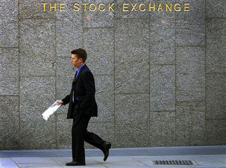 A young professional walks past the London Stock Exchange in a 2001 file photo. Gen Xers get a bad rap. They're often portrayed as slackers and runaway spenders who don't know how to work or save. Not so, says new research sponsored by Charles Schwab Corp., one of several financial services companies trying to draw a bead on this age 27-to-42 demographic. REUTERS/Stephen Hird