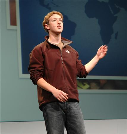 Mark Zuckerberg, founder of Facebook -- a social networking site he started for Harvard undergraduates that has turned into a global phenomenon -- speaking to a crowd of hundreds software developers at the company's first-ever conference in San Francisco on Thursday. The 23-year-old CEO announced plans to open up the site to allow outside companies ranging from Microsoft to Amazon.com to Photobucket and Twitter to build Web applications for Facebook's 24 million active members. REUTERS/Anders Frick/handout