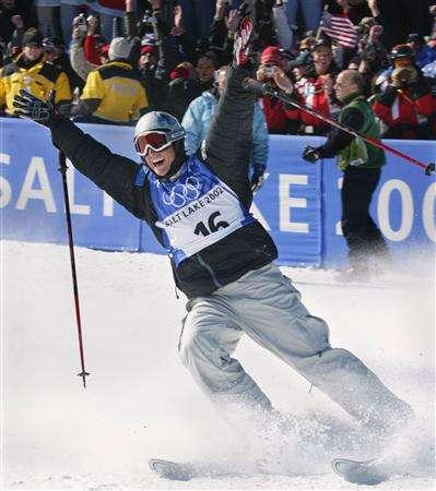 Jonny Moseley of the United States at the Salt Lake 2002 Olympic Winter Games in Deer Valley, February 12, 2002 file photo. The Ski Channel has signed a multifaceted partnership with Moseley that will see the Olympic gold medalist and TV personality take a big role in the network, which is set to launch in first-quarter 2008. REUTERS/Eric Gaillard