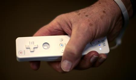 A resident at the Greenspring Village Community in Springfield, Virginia holds a ''Wiimote'' as he plays with the community's new Wii videogame console March 22, 2007. Wiiitis -- pronounced ''wee-eye-tis'' -- is the latest ailment to develop from the video game era, beginning with Space Invaders' wrist in 1981, which was caused by the repeated button mashing required by the popular arcade game. REUTERS/Kevin Lamarque