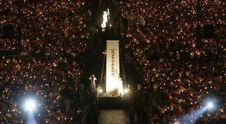Protesters take part in a candlelight vigil at Hong Kong's Victoria Park, June 4, 2007 to mark the 18th anniversary of the military crackdown on the pro-democracy movement in Beijing's Tiananmen Square in 1989. A newspaper in southwest China has sacked three of its editors over an advertisement saluting mothers of protesters killed in the 1989 Tiananmen Square crackdown, a source with knowledge of the gaffe said on Thursday. REUTERS/Paul Yeung