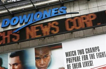 The Dow Jones news ticker in New York's Times Square displays the headline that News Corp. is bidding to buy the company, May 1, 2007. Philadelphia Media Holdings Chief Executive Brian Tierney said on Thursday he is interested in bidding with partners for Dow Jones & Co. Inc. REUTERS/Brendan Mcdermid