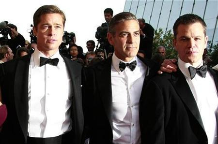 Cast members (L-R), Brad Pitt, George Clooney and Matt Damon arrive for the world premiere of U.S. director Steven Soderbergh's film ''Ocean's 13'' at the 60th Cannes Film Festival May 24, 2007. The all-star caper film ''Ocean's Thirteen'' made off with $37.1 million in North American ticket sales during its opening weekend to steal the No. 1 spot at the weekend box office, according to studio estimates on Sunday. REUTERS/Eric Gaillard