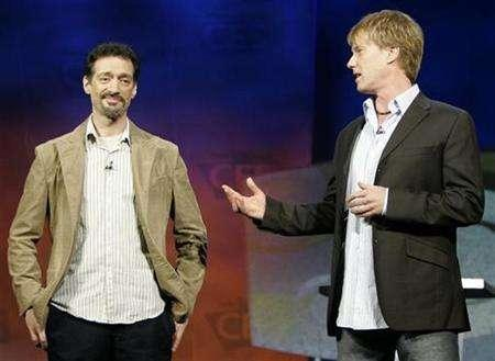 Anthony Cumia (L) and Gregg ''Opie'' Hughes of the Opie and Anthony radio show speak at the 2007 International CES in Las Vegas, January 9, 2007. Shock jocks Opie & Anthony will resume live broadcasts on XM Satellite Radio Holdings on Friday following a one-month suspension after a guest described his rape fantasies on their daily show, the satellite radio provider said on Monday. REUTERS/Rick Wilking