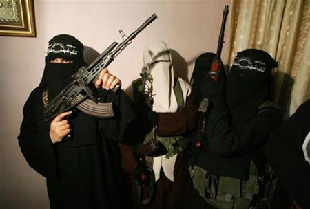 Female Palestinian would-be suicide bombers attend a news conference in Gaza May 21, 2007. Violent Muslim, Christian and Jewish extremists invoke the same rhetoric of ''good'' and ''evil'' and the best way to fight them is to tackle the problems that drive people to extremism, according to a report obtained by Reuters. REUTERS/Mohammed Sale
