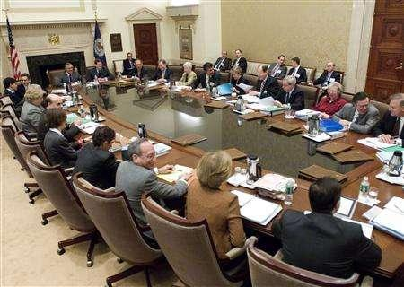 The Board of Governors attend a Federal Open Market Committee meeting in Washington, March 28, 2006. The Fed will keep interest rates steady through 2008, median forecasts in a Reuters poll showed on Thursday, a sharp change from a month ago when they pointed to a quarter point cut later this year. REUTERS/U.S. Federal Reserve/Handout
