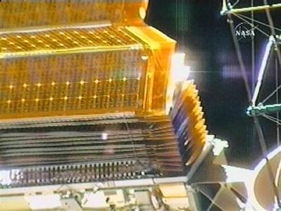 This image from NASA TV shows folding panels of the starboard solar array on the Port 6 (P6) truss that International Space Station crewmembers are working to retract, June 14, 2007. REUTERS/NASA