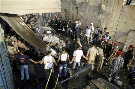 Plainclothes Lebanese policemen secure an explosion site in Beirut June 13, 2007. REUTERS/Jerry Lampen