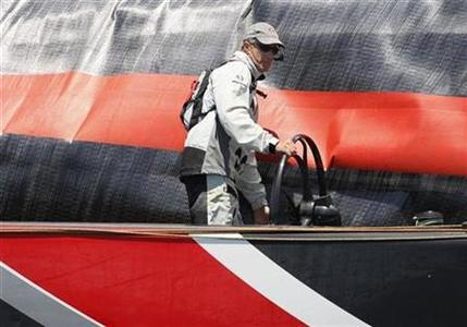 In this file picture, America's Cup defender Alinghi's helmsman Ed Baird steers one of the Alinghi yachts while practising in preparation for the America's Cup match race, in Valencia, June 2, 2007. Baird will helm Alinghi in the America's Cup, skipper Brad Butterworth said on announcing the defending champion's first crew on Friday. REUTERS/Victor Fraile