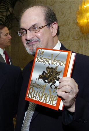 Author Salman Rushdie poses with his 1988 book ''The Satanic Verses'' before the American Jewish Conference's 30th Annual Dinner, ''Profiles in Courage: Voices of Muslim Reformers in the Modern World,'' in Beverly Hills, California in this September 17, 2006 file photo. Iran's parliament speaker said on Sunday the award of a knighthood to author Salman Rushdie, whose novel ''The Satanic Verses'' outraged many Muslims, was a shameless act and would not go without a Muslim response. REUTERS/Chris Pizzello/File
