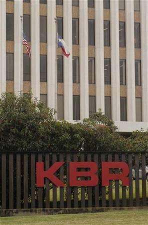 A KBR (Kellogg, Brown and Root) sign adorns the Halliburton corporate headquarters near downtown Houston, December 12, 2003. KBR, a former unit of Halliburton Co. <HAL.N>, Dyncorp International Inc. and Fluor Corp. were awarded parts of a U.S. Army contract with a combined potential value of up to $150 billion to provide services to the military in the Middle East. REUTERS/Tim Johnson