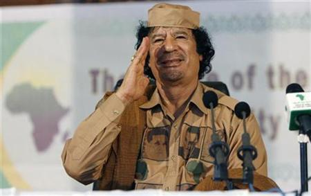Libyan leader Muammar Gaddafi gestures during a speech at the University of Ghana in Accra June 30, 2007. REUTERS/Luc Gnago