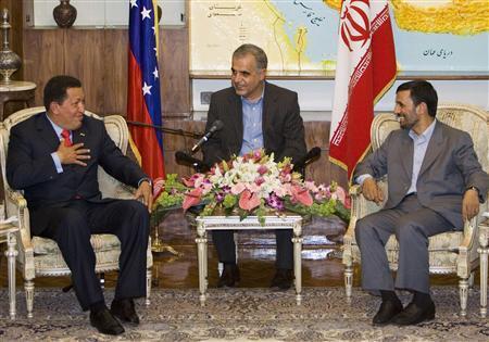 Iranian President Mahmoud Ahmadinejad (R) meets his Venezuelan counterpart Hugo Chavez in Tehran July 1, 2007. REUTERS/Raheb Homavandi