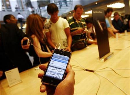 The new iPhone is held inside the Apple Store in New York June 29, 2007. Deutsche Telekom's mobile phone unit T-Mobile clinched a deal to bring Apple Inc's iPhone handset to Germany, according to a report in a German daily. REUTERS/Shannon Stapleton
