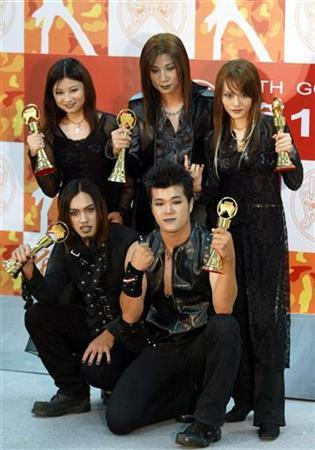 A file photo of members of band the Chthonic posing with their awards for the Best Band at the 14th Golden Melody Awards in Taipei on August 2, 2003. REUTERS/Kenny Wu