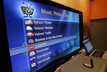 A screen shows Internet services available through an broadband-connected TiVo digital video recorder at the Consumer Electronics Show in Las Vegas, Nevada, in this file photo from January 5, 2006. TiVo Inc. on Tuesday said many of its customers can now order pay-per-view movies and television shows from Amazon.com's download service directly from their TV, without a personal computer. REUTERS/Steve Marcus