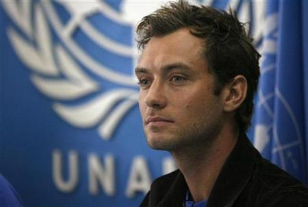 British actor and Peace One Day Ambassador Jude Law, takes a question during a news conference in Kabul July 19, 2007. Law has been filming a feature-length documentary in Afghanistan with Peace One Day, an organization promoting a worldwide ceasefire each year on September 21. REUTERS/Ahmad Masood