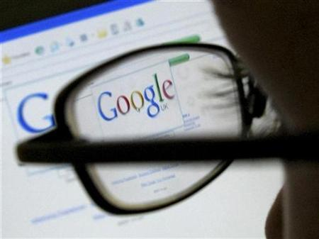 A Google search page is seen through the spectacles of a computer user in Leicester, central England July 20, 2007. Microsoft Corp.'s Bill Gates does not see Google Inc. becoming a successful competitor in the market for software for cellular phones, the New York Times reported on its Web site on Monday. REUTERS/Darren Staples