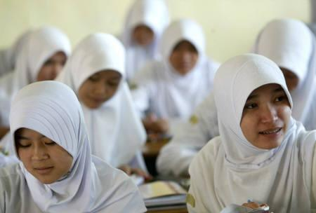 Muslim student girls attend a class meeting at the Darul Muttaqien Islamic boarding school in Bogor, August 1, 2007. Islamic boarding schools in Indonesia, the world's biggest Muslim nation, largely escaped the spotlight in the wake of the September 11, 2001, attacks on the United States. REUTERS/Dadang Tri