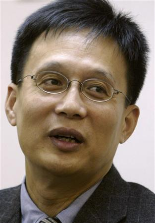 Ma Lik speaks to reporters after becoming the new chairman of the Democratic Alliance for Betterment of Hong Kong (DAB), the territory's largest pro-Beijing party, in Hong Kong in this December 10, 2003 file photo. Ma died in a Guangzhou hospital on August 8, 2007 at the age of 55. He was diagnosed with colon cancer in 2004, local media reported. REUTERS/Bobby Yip/Files