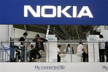 People visit Nokia's stand during the 3GSM World Congress in Barcelona, February 15, 2007. Nokia, the world's top cell phone maker, said on Wednesday it would defend itself and its products against complaints Interdigital has filed in courts in the United States. REUTERS/Albert Gea