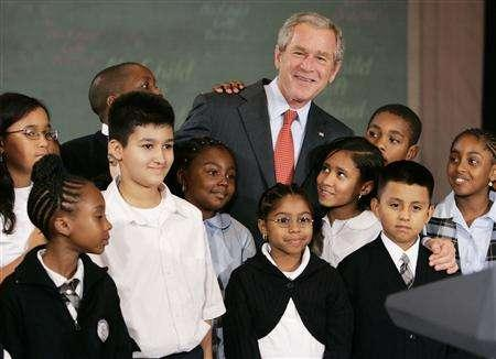 U.S. President George W. Bush poses with children from Public School 76 after giving a progress report on his Administration's No Child Left Behind program at the Waldorf Astoria Hotel in New York, September 26, 2007. REUTERS/Larry Downing