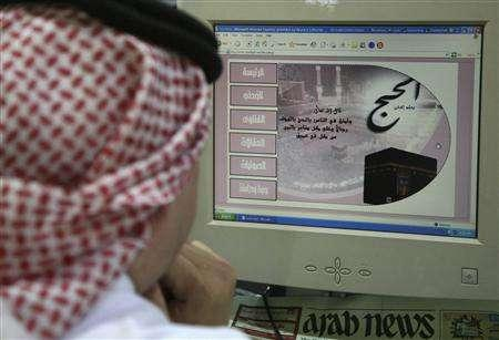 A Saudi man looks at a Web site on fatwas in Riyadh December 10, 2007. The number of fatwas, or edicts on belief and behaviour, is ever exploding in Islamic countries as Web sites, television and radio vie to outdo the mosque, but that doesn't mean believers automatically heed their message. REUTERS/Ali Jarekji
