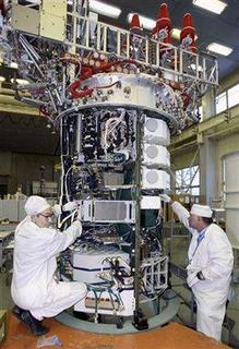 Engineers work on a Global Navigation Satellite System (GLONASS) satelite at the NPO PM applied mechanics institute in the Siberian city of Zheleznogorsk near Krasnoyarsk, in this November 23, 2006 file photo. Russia successfully launched a rocket on Tuesday carrying the last three satellites to complete a navigation system to rival America's GPS. REUTERS/Ilya Naymushin/Files