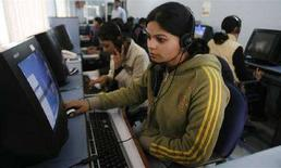 <p>Dipendenti di un call canter in India.. REUTERS/Rupak De Chowdhuri</p>