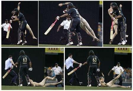 A combination of pictures shows Australia's Andrew Symonds colliding with a streaker during the second final of the tri-series one-day international cricket match against India in Brisbane March 4, 2008. REUTERS/Steve Holland