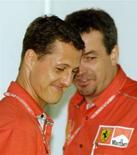 <p>Immagine d'archivio dell'ex capo meccanico della Formula Uno Nigel Stepney (a destra) con l'allora pilota di F1Michael Schumacher. GN/HB</p>