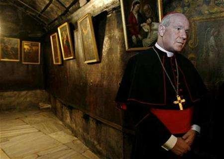 Vienna Cardinal Christoph Schoenborn visits the grotto believed by Christians to be the birthplace of Jesus in the Church of the Nativity during his visit to the West Bank city of Bethlehem November 9, 2007. REUTERS/Eliana Aponte