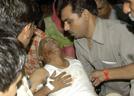 A injured man receives treatment after a series of bomb blasts in Jaipur May 13, 2008. REUTERS/Vinay Joashi via You Witness News
