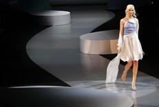 <p>A model displays a creation as part of the Giorgio Armani Spring/Summer 2009 women's collection during Milan Fashion Week September 22, 2008. REUTERS/Stefano Rellandini</p>
