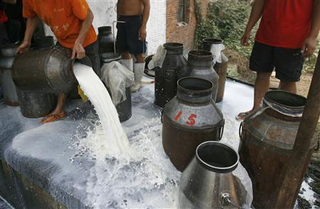 Milk is seen being poured away due to the closure of a milk factory on the outskirts of Wuhan, Hubei province September 21, 2008. Fed up with an almost constant diet of bad news about quality and safety problems, some Chinese are taking out their frustrations with biting jokes on the Internet about the seemingly never-ending scandals. REUTERS/Stringer (CHINA). CHINA OUT. NO COMMERCIAL OR EDITORIAL SALES IN CHINA.