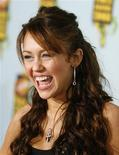 "<p>Singer Miley Cyrus smiles at the Kids' Choice Awards in Los Angeles in this March 29, 2008 file photograph. Cyrus and Disney Channel sought to shoot down rumours on Monday that the teen sensation of the TV hit ""Hannah Montana"" was seeking to part ways with the show that made her a star. REUTERS/Mario Anzuoni/Files</p>"