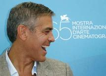 <p>George Clooney laughs during a photocall in Venice, August 27, 2008. REUTERS/Denis Balibouse</p>