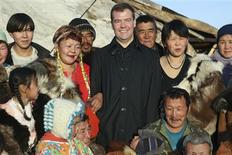 <p>Russian President Dmitry Medvedev (C) poses for a picture with reindeer herders in the town of Kanchalan in the Chukotka region, September 23, 2008. REUTERS/RIA Novosti/Dmitry Astakhov/Pool</p>