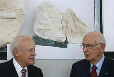 <p>Italy's President Giorgio Napolitano (R) and his Greek counterpart Karolos Papoulias stand next to to a fragment from the Parthenon's frieze, which Italy returned to Greece, during their visit at the New Acropolis museum in Athens September 24, 2008. REUTERS/John Kolesidis</p>
