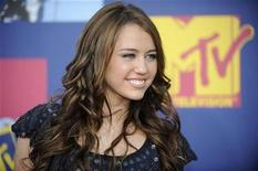 <p>Singer, actress Miley Cyrus arrives at the 2008 MTV Video Music Awards in Los Angeles September 7, 2008. REUTERS/Phil McCarten</p>