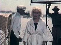 "<p>A still from an amateur film of Marilyn Monroe on the film set of ""Some Like It Hot"" obtained September 4, 2008. An amateur film of Hollywood legend Marilyn Monroe on the set of ""Some Like It Hot"" has surfaced in Australia almost 50 years after it was shot and is being put up for auction. Auctioneer Charles Leski said the 2.5-minute-long, 8mm film shows Monroe and co-star Tony Curtis on the set ahead of shooting a beach scene in which the actress is bouncing balls to get the actor's attention. REUTERS/Charles Leski Auctions/Handout</p>"