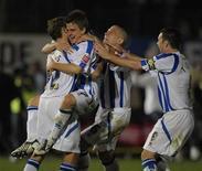 <p>Jogadores do Brighton & Hove Albion celebram após vencer o Manchester City na Copa da Liga Inglesa em 24 de setembro. REUTERS/Kieran Doherty</p>